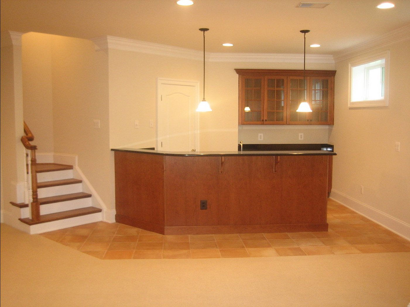 photo of a wet bar in a finished basement remodel. Black Bedroom Furniture Sets. Home Design Ideas