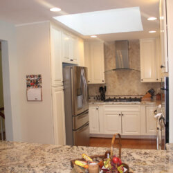 Refrigerator and stove in remodeled kitchen