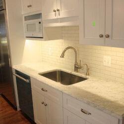 Sink in white remodeled kitchen