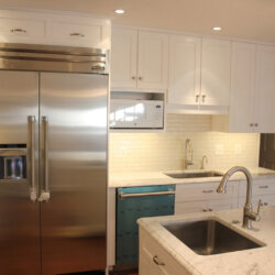 New kitchen with stainless steel fridge