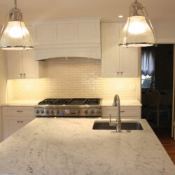 Remodeled kitchen with island sink and gas range