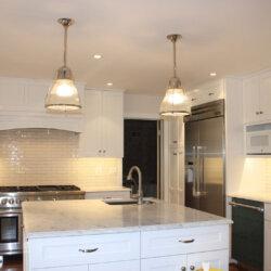 Hanging light fixtures in renovated kitchen