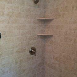 Built-in shelves in shower in remodeled bathroom