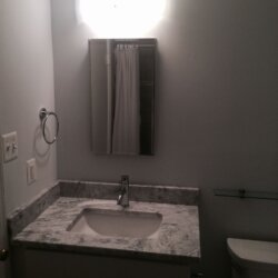 Gray remodeled bathroom in Rockville, MD