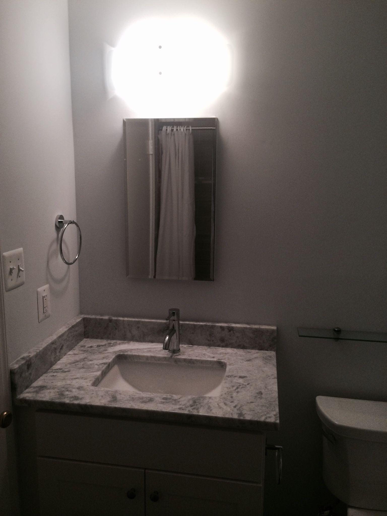 Gray remodeled bathroom in Rockville, MD