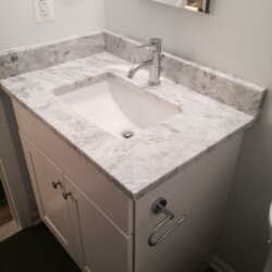 Gray sink in remodeled bathroom