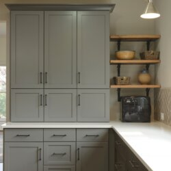 Gray drawers and cabinets in renovated kitchen