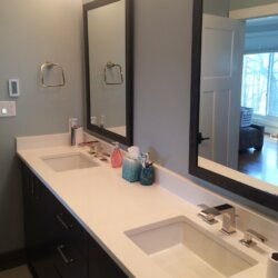 Double bathroom sinks with matching vanity mirrors