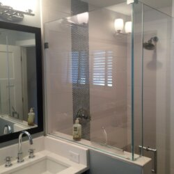 Bathroom sink and glass walled shower