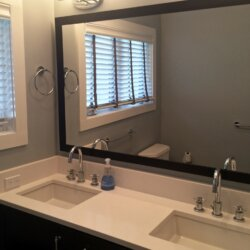 Bathroom mirror and matching sinks