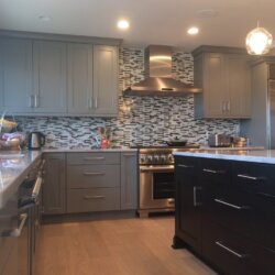 Remodeled kitchen with gray and black cabinets