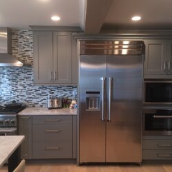 Stainless steel fridge in remodeled kitchen