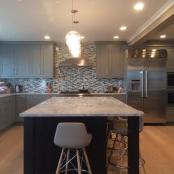 Gray kitchen with white stone island