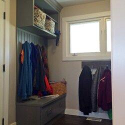 Coats hanging in new mudroom