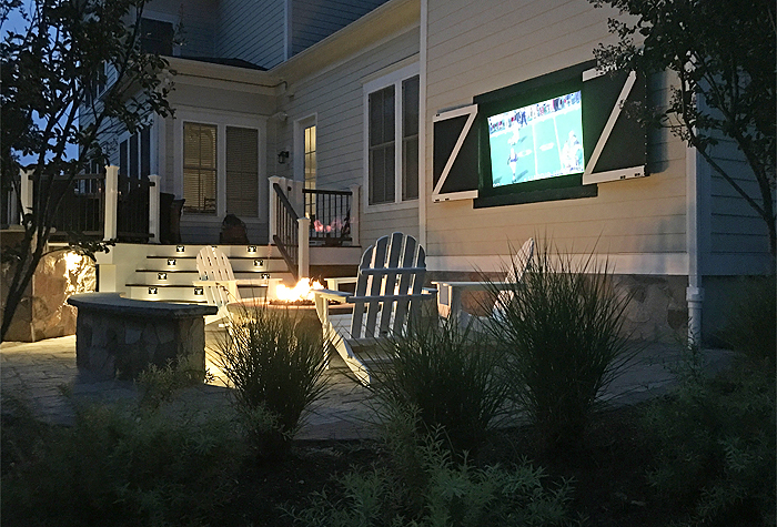 Photo: adding a fireplace to a patio - outdoor living fire pit by MBRG