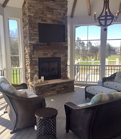 Photo: adding a fireplace to a screened porch