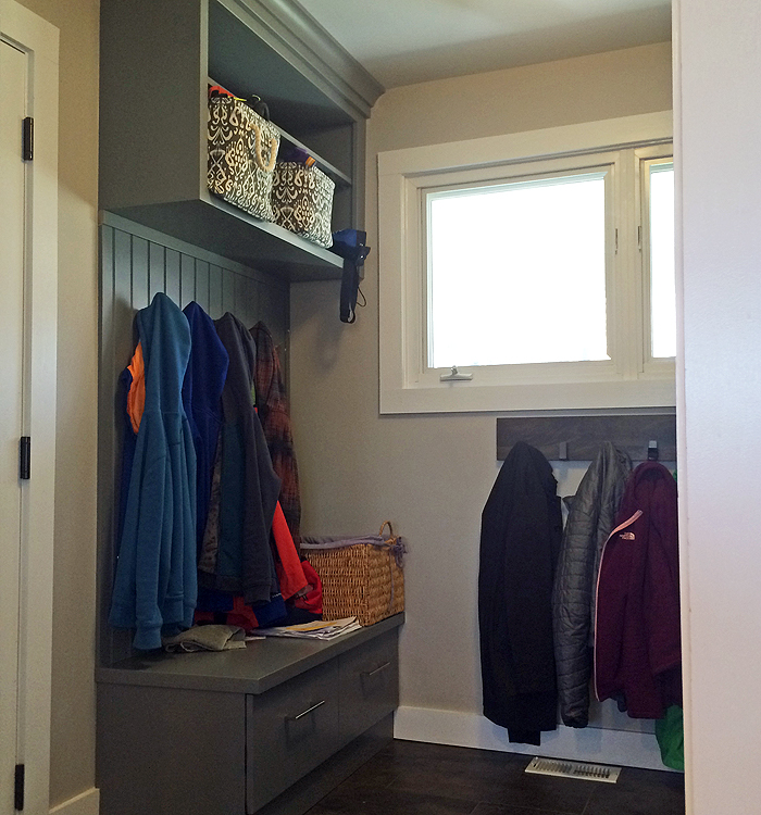 Photo: home remodeling with entry bench and coat hooks
