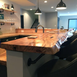 Closeup of natural edge wood bar top in basement