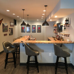 Remodeled basement bar with wood floor