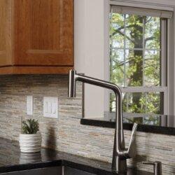 Elegant kitchen faucet and black stone countertop