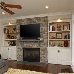 FlatscreenTV mounted above stone fireplace