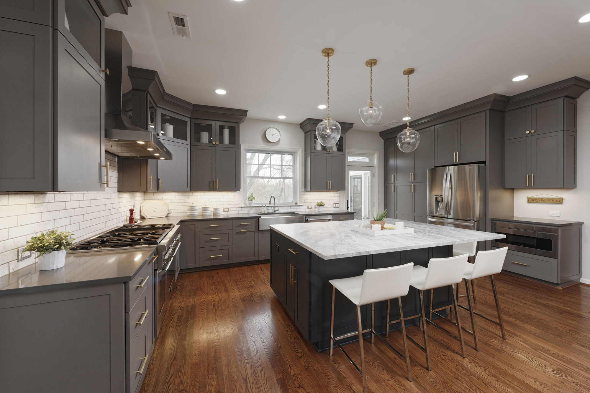 Dark gray cabinets in modern kitchen remodel