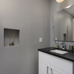 Modern gray bathroom sink and wall alcove