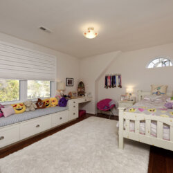 Kid's bedroom with emoji pillows and bay window
