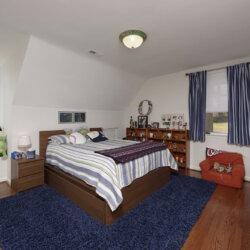 Boy's bedroom with blue rug