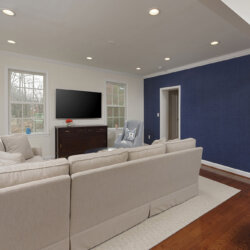 Remodeled living room with textured blue wall