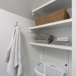 Linen shelves in white bathroom