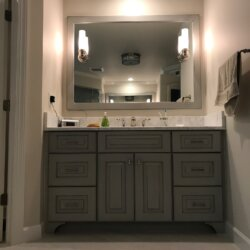 Master bathroom vanity with gray cabinetry