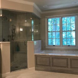 Gray master bathroom tub and corner shower