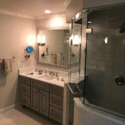 Glass walled corner shower in master bathroom