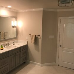 Sinks and door in remodeled master bathroom