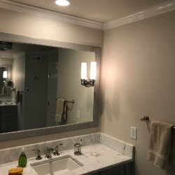 Sink and mirror in remodeled bathroom