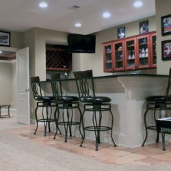 finished basement wet bar and chairs
