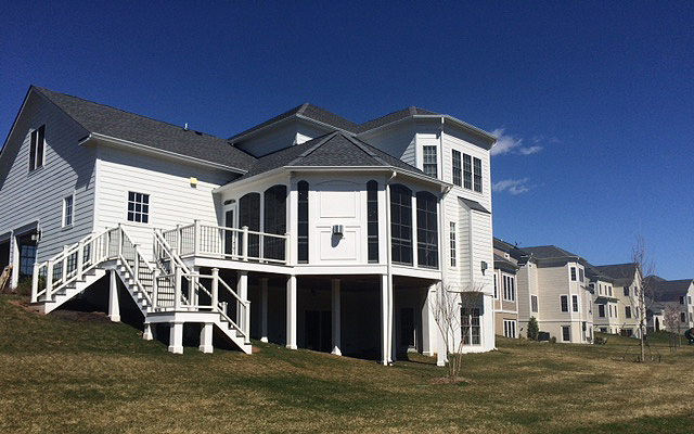Deck and sunroom by MBRG