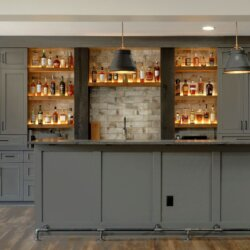 custom shelves and cabinets behind Finished Basement Ashburn VA