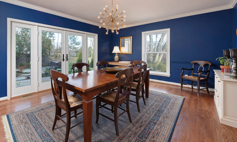 dining room with large window and doors