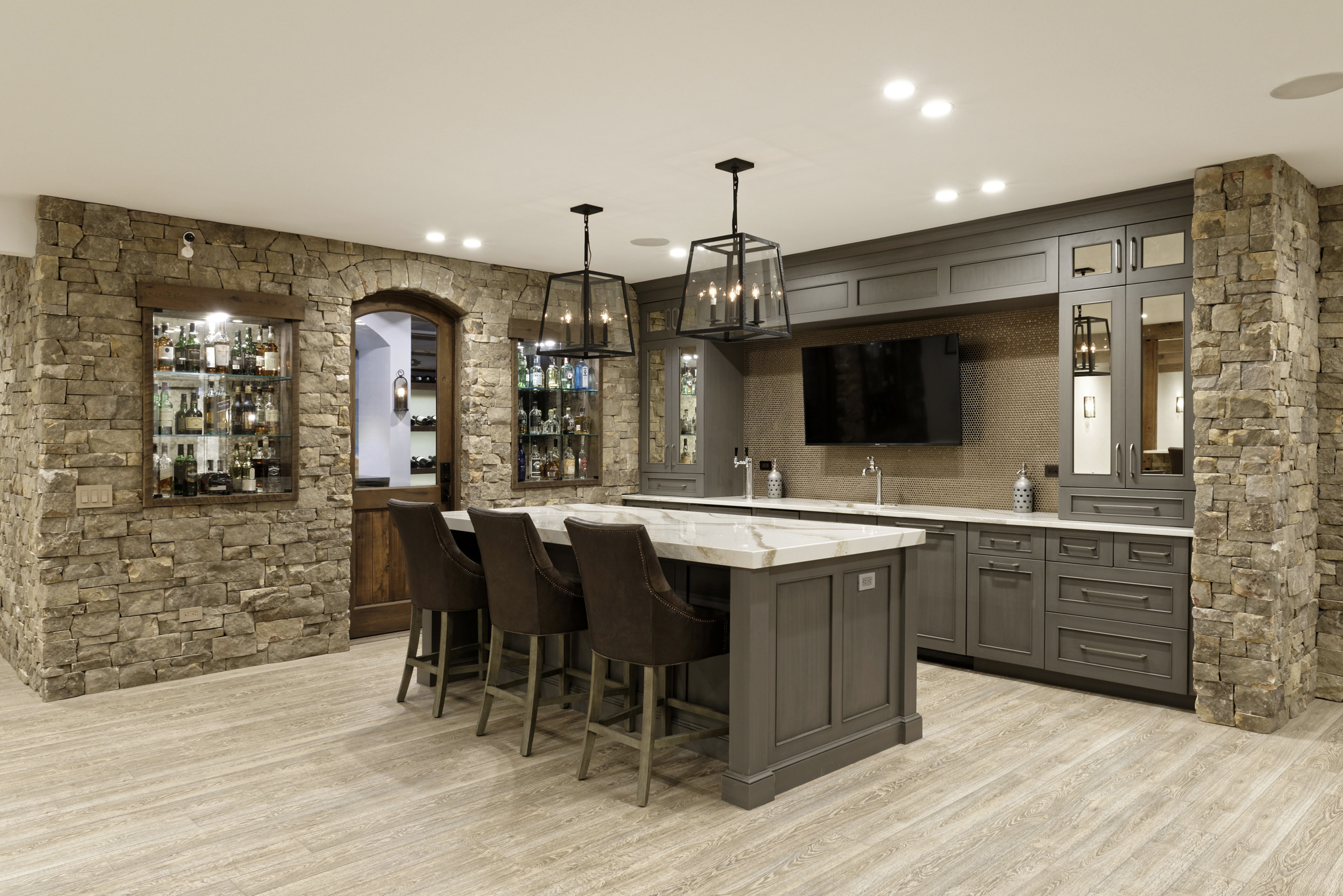 finished basement with stone walls, wet bar and wine cellar