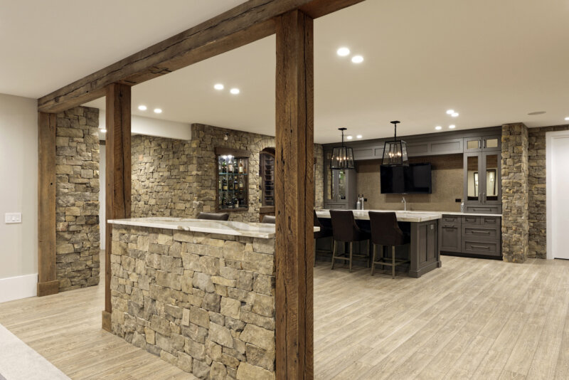 Reclaimed beams in finished basement wine cellar and bar