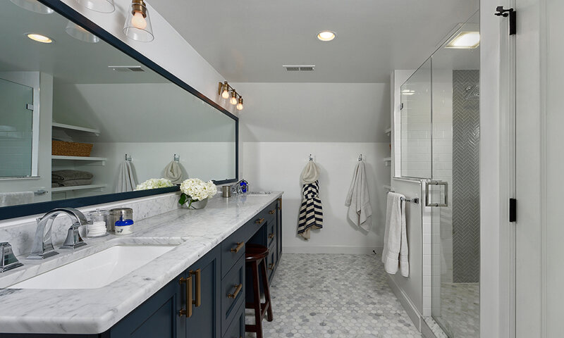 Large bathroom with 2 sinks and glass shower stall